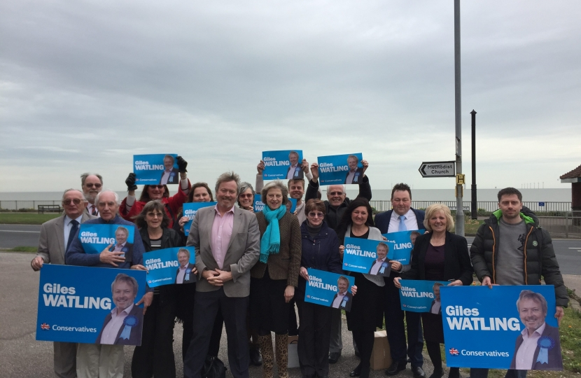 Giles Watling and Theresa May with activists in Holland on Sea